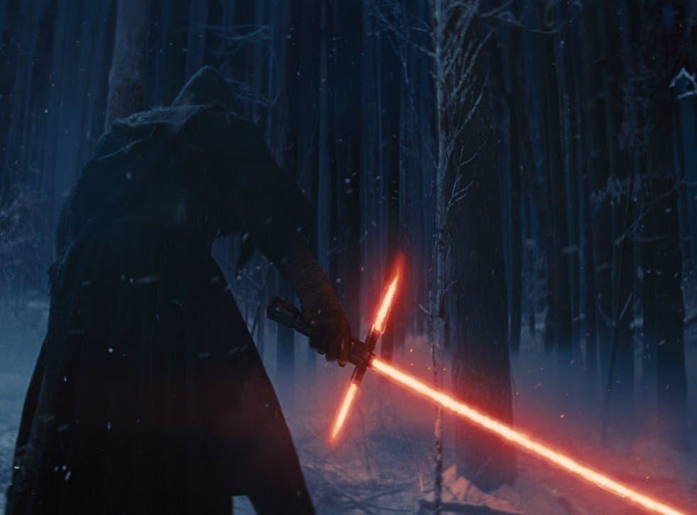 Kylo Ren ignites his lightsaber in Star Wars: The Force Awakens
