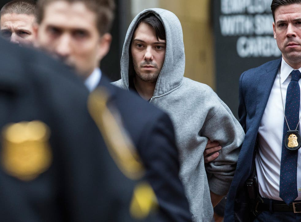 Martin Shkreli, the former CEO of Turing Pharmaceutical, being arrested for securities fraud
