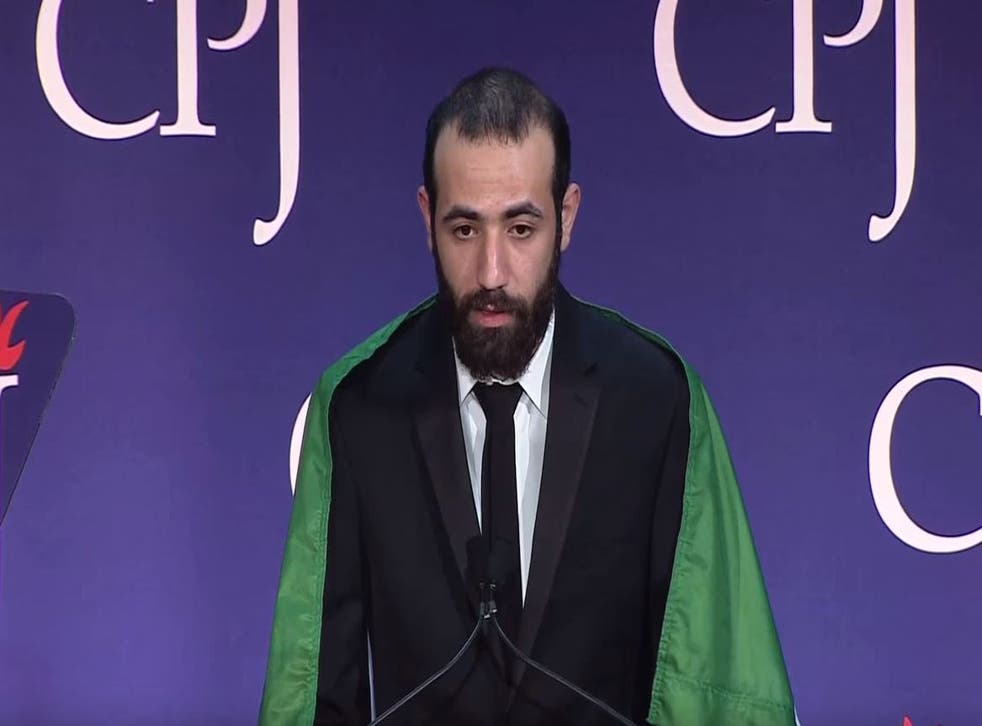 A member of Raqqa Is Being Slaughtered Silently collecting the 2015 International Press Freedom Award