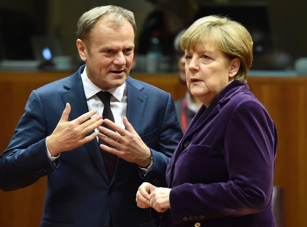European Council president Donald Tusk, left, with German Chancellor Angela Merkel at the European Union (EU) summit