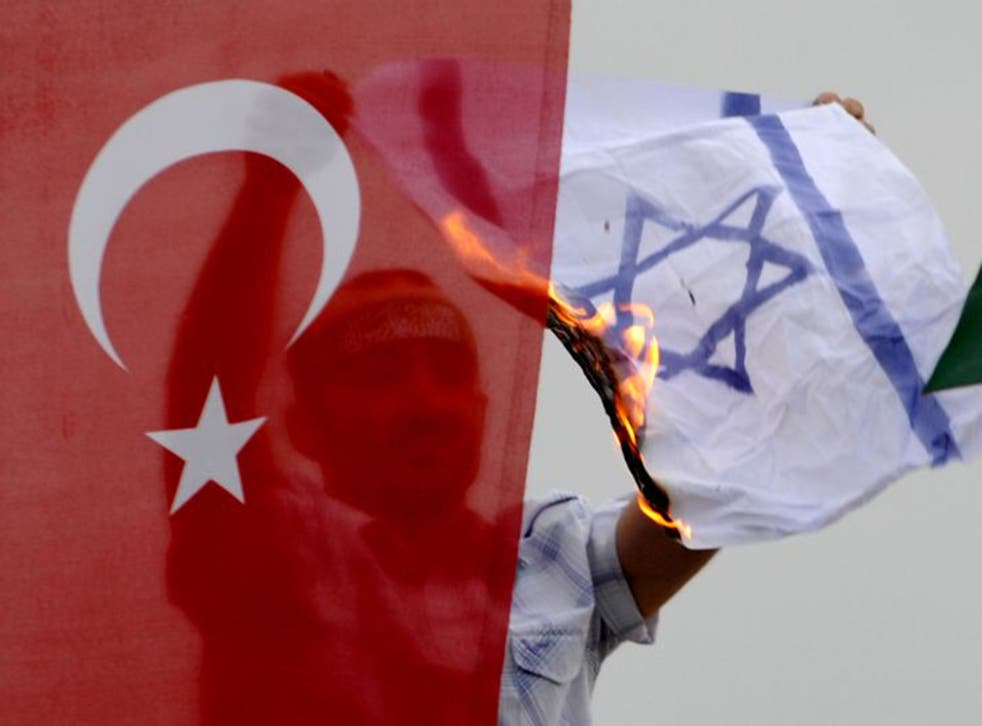 A demonstrator burns an Israeli flag a during a protest against Israel in Istanbul in 2010