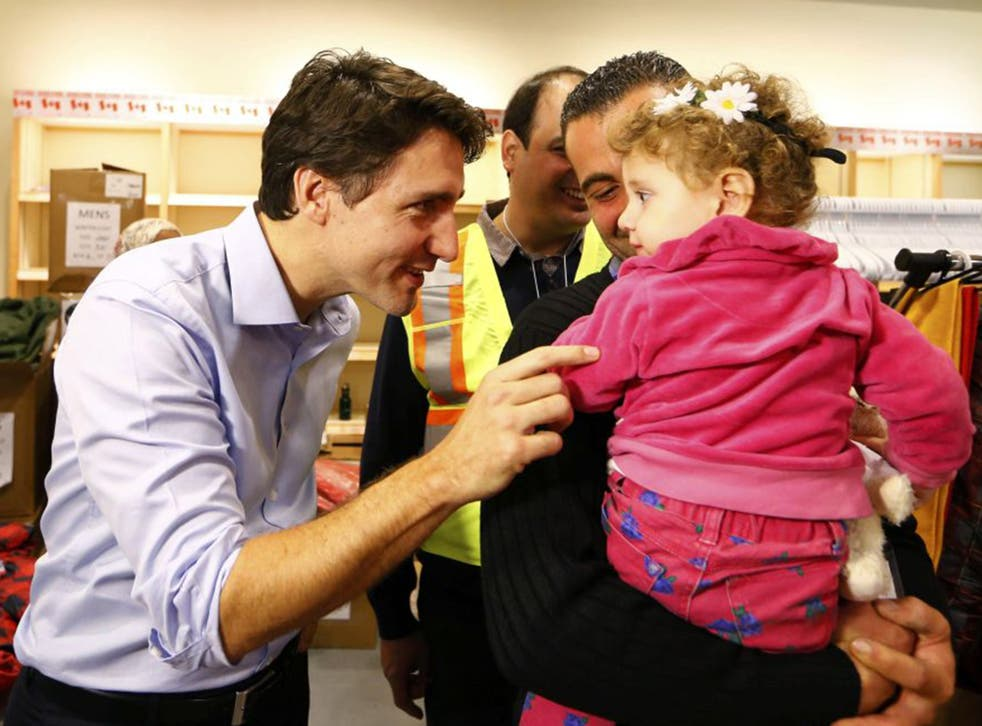 Justin Trudeau greets Syrian refugee arrivals at Toronto airport last week