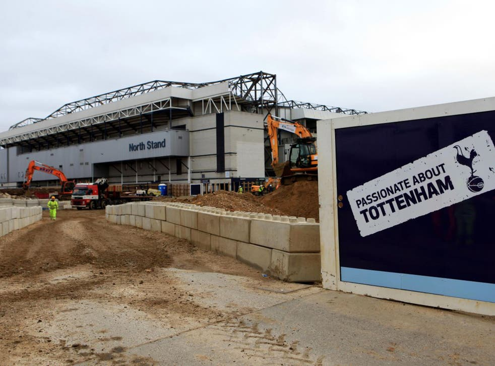 Builders work on the preparations for the new 61,00-capacity White Hart Lane, which Tottenham hope to open in 2018