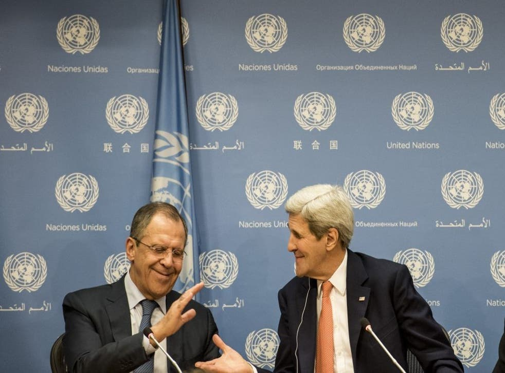 Sergei Lavrov of Russia and John Kerry of the US shake hands