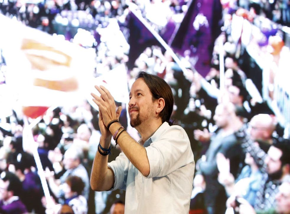 Pablo Iglesias, leader of Podemos party, applauds during a closing campaign rally in Valencia, Spain