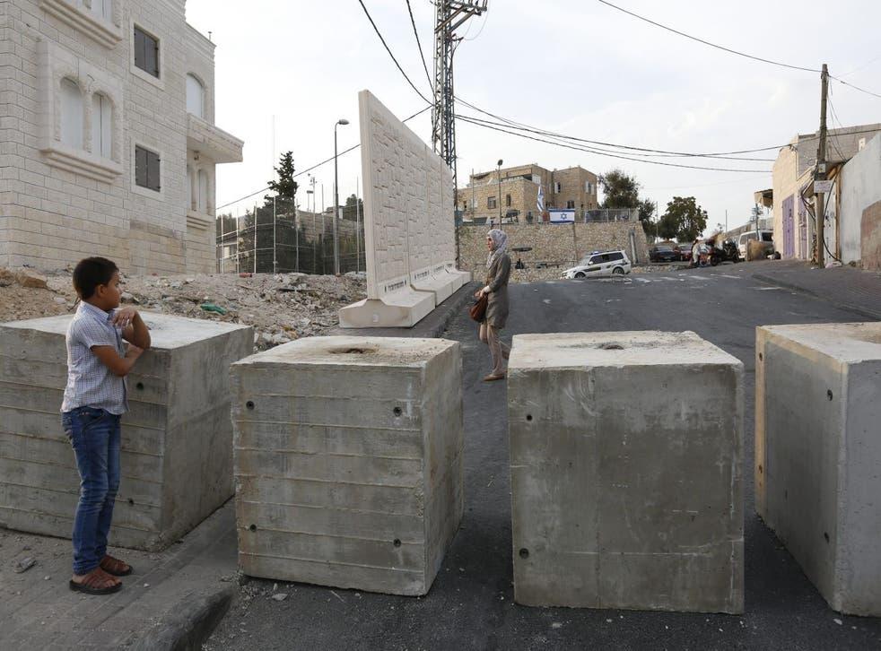 Palestinians near a checkpoint in Jebel Mukaber, east Jerusalem