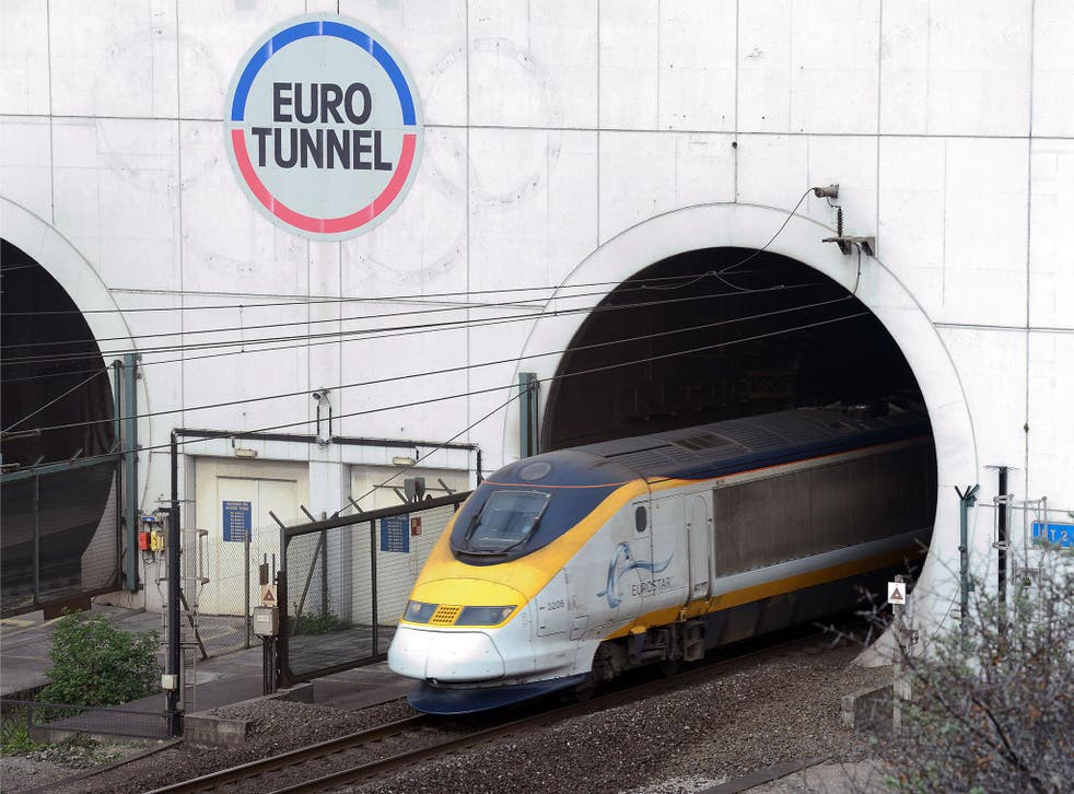 A Eurostar train emerges from the Channel Tunnel, owned by EuroTunnel