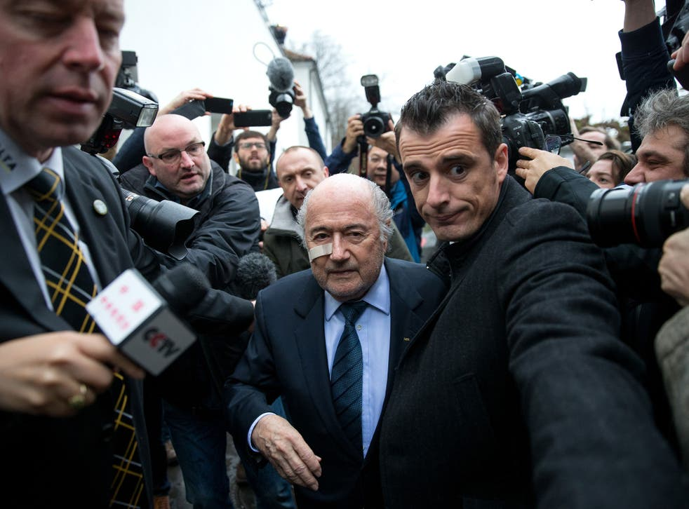 Fifa president Sepp Blatter arrives for a press conference after being banned from football for eight years