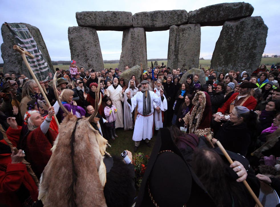 Druids and pagans take part in a Winter Solstice ceremony at Stonehenge in 2011