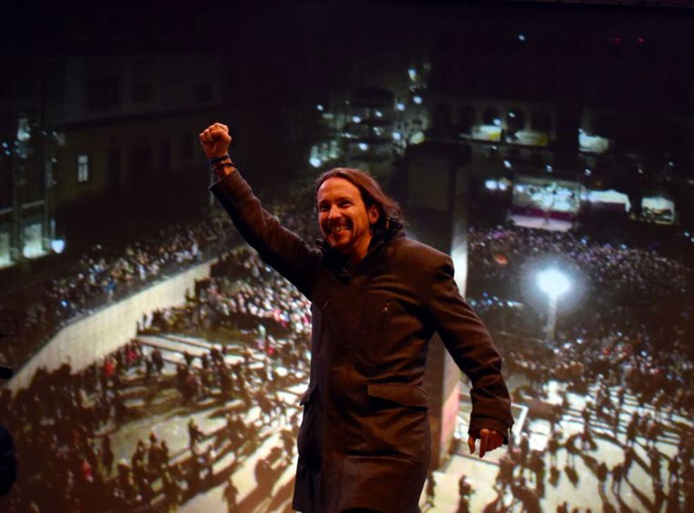 The Podemos leader, Pablo Iglesias, celebrating the results of the general elections in which the party won 69 seats in congress, ensuring the ruling PP no longer forms a majority