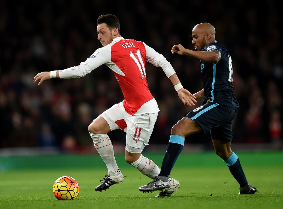 Mesut Ozil in action for Arsenal against Manchester City