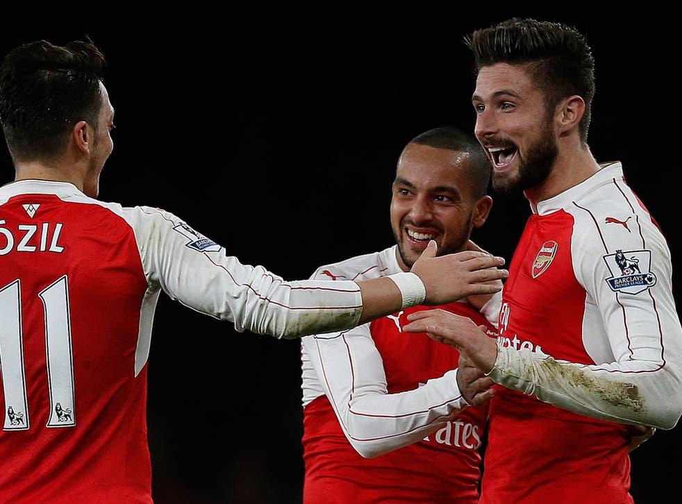 Olivier Giroud celebrates his goal with Theo Walcott and Mesut Ozil