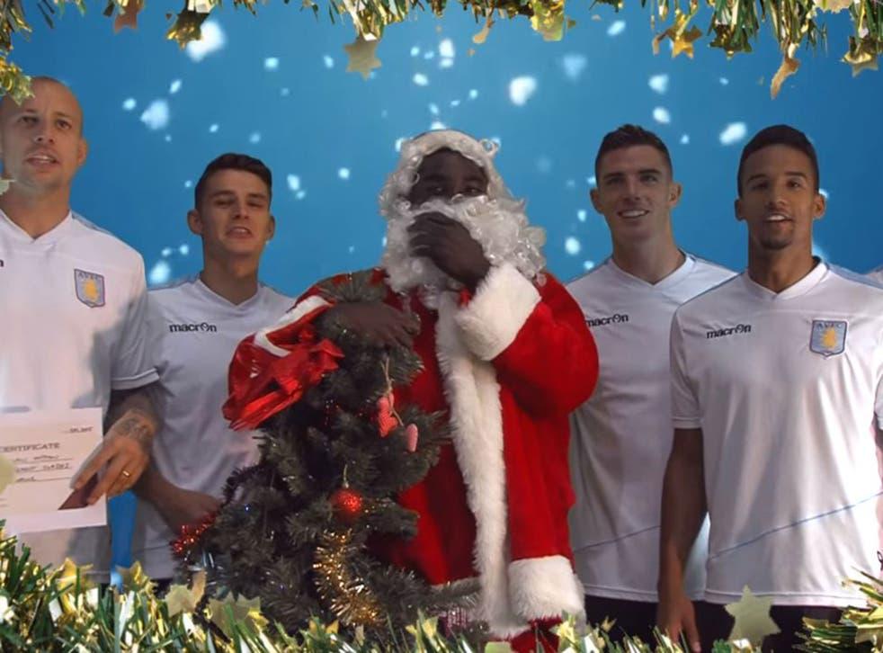 Micah Richards dressed up as Santa Claus alongside his Aston Villa team-mates