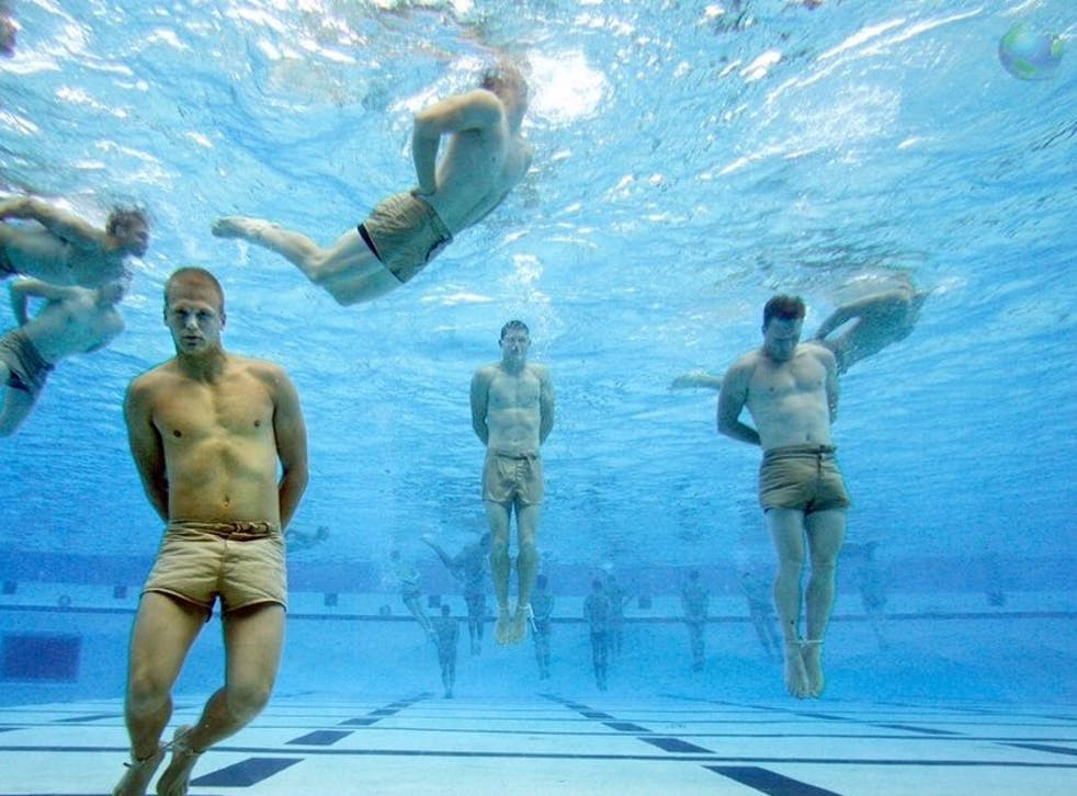 Navy SEALs during drown-proofing training