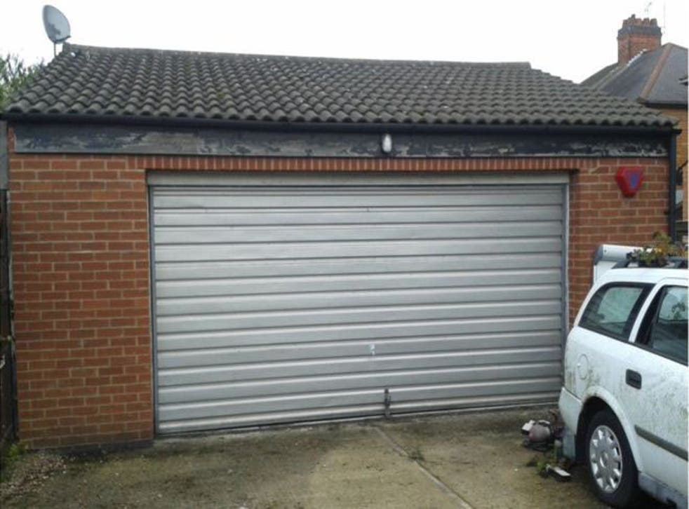 The detached double garage where a Portuguese family of three were found to be living