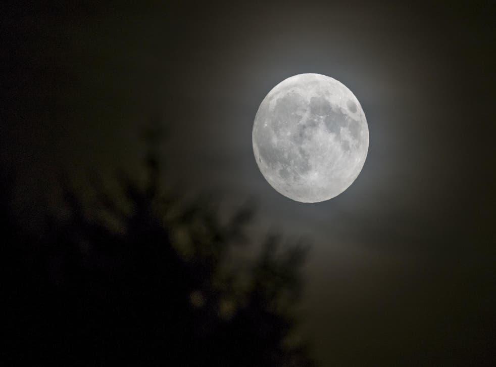 The full moon rises over Lausanne, France, in September 2015