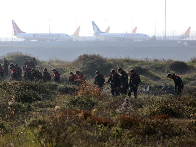 Turkish police search around Sabiha Gokcen Airport after an explosion left one dead and extensive damage to planes on 23 Decenber 2015.