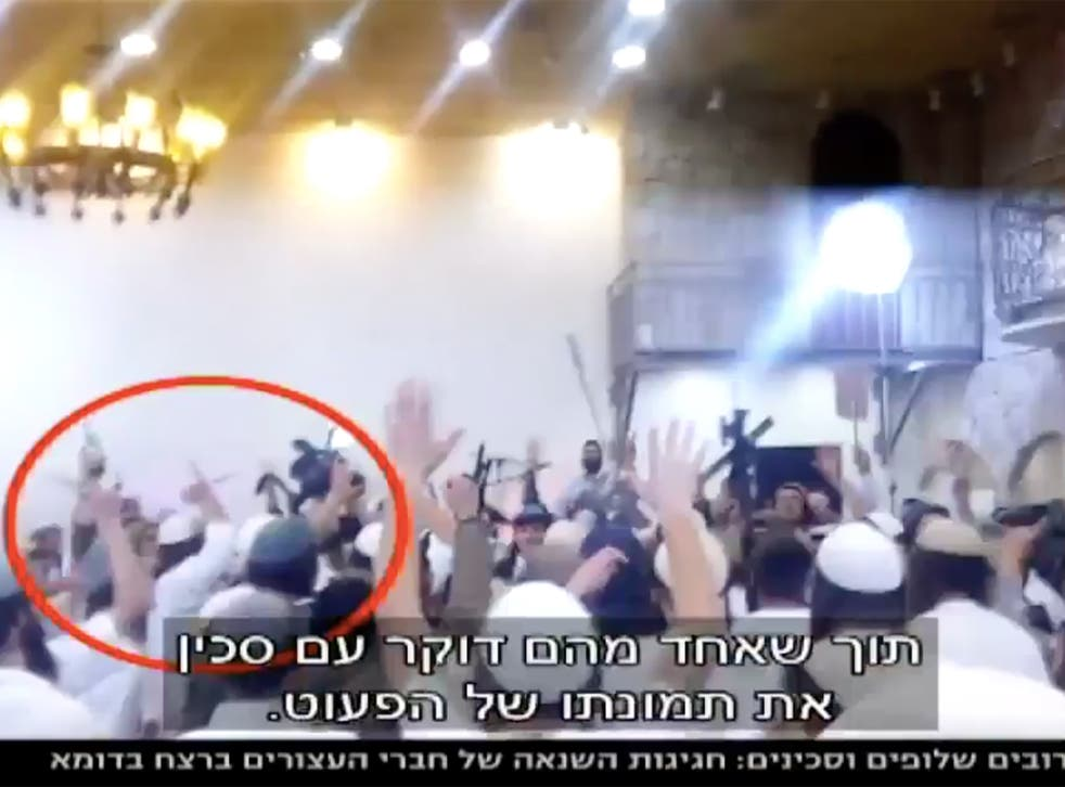 The video was shown on Israeli TV channel News 10 and showed wedding guests dancing with guns and knives