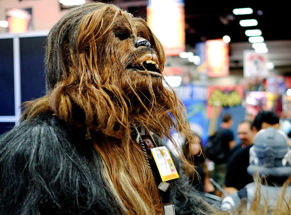 Christopher Petrone, of San Diego, CA, towering over attendees in his handmade, to-scale Chewbacca costume, during the 45th annual San Diego Comic-Con