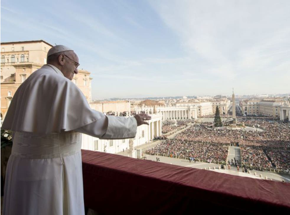 """Pope Francis delivers his """"Urbi et Orbi"""" (to the city and to the world) blessing from the central balcony of St. Peter's Basilica at the Vatican"""