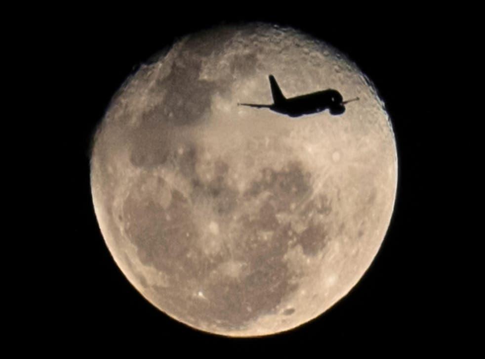 The full moon rises over Rio de Janeiro in Brazil