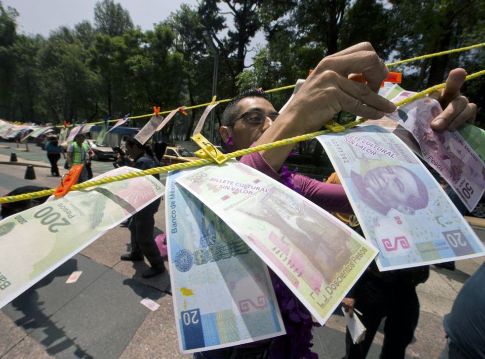 A protest over drug money in Mexico City – the US government estimates that over £19bn in laundered money crosses the border with Mexico each year