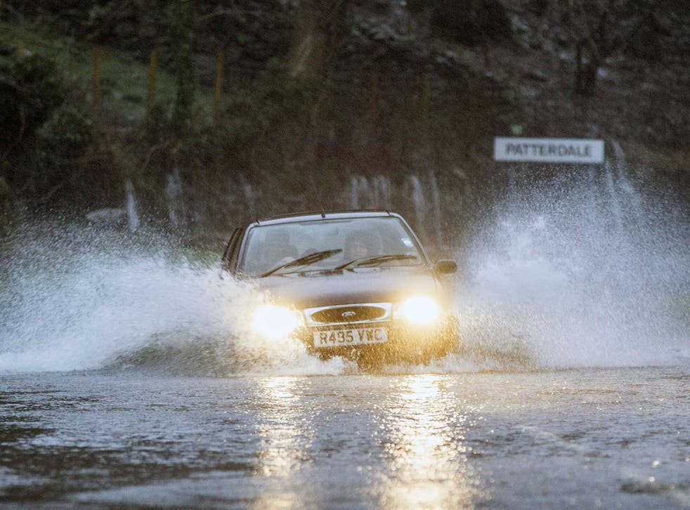 A car battles through flooded roads in Patterdale
