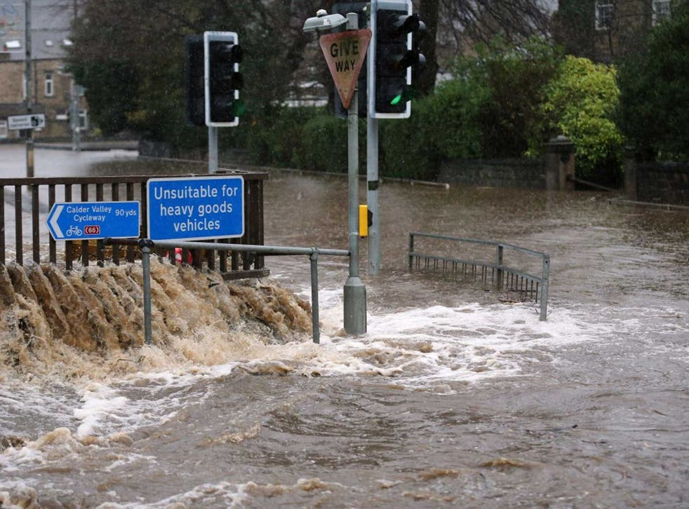 The River Calder bursts its bank's in the Calder Valley town of Mytholmroyd