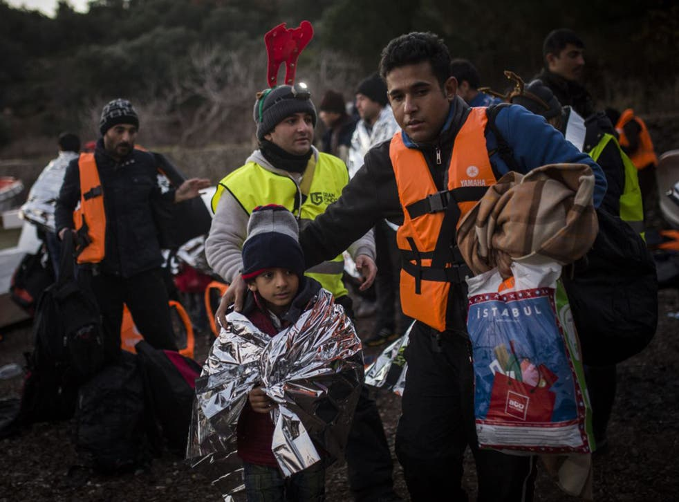 Refugees arrive on the Greek island of Lesvos on Christmas Eve