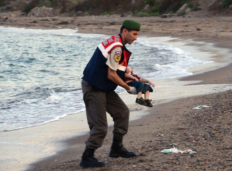 Image of 2015: Aylan Kurdi's body is taken from a beach  in Turkey last September