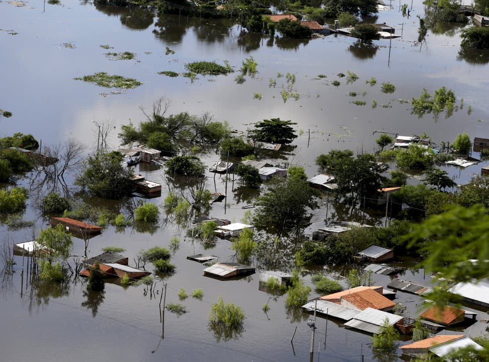 Houses are partially submerged in floodwaters in Asuncion, Paraguay
