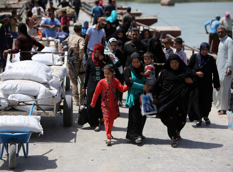 Sunni Iraqis fleeing violence in Ramadi arriving in Baghdad; more than 90,000 people have fled fighting between pro-government forces and Isis in the Ramadi area