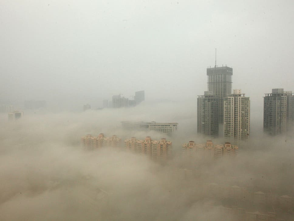 Higher pollution leads to a higher crime rate research indicates buildings are shrouded in smog in lianyungang china fandeluxe Images