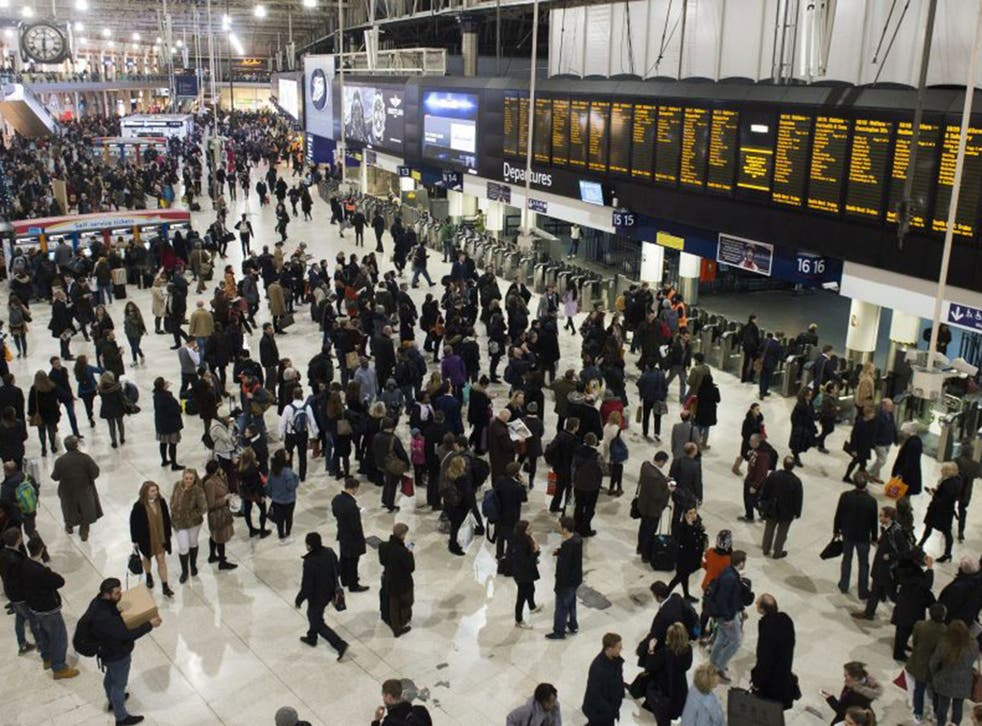 Commuters prepare to travel home for Christmas from London's Waterloo