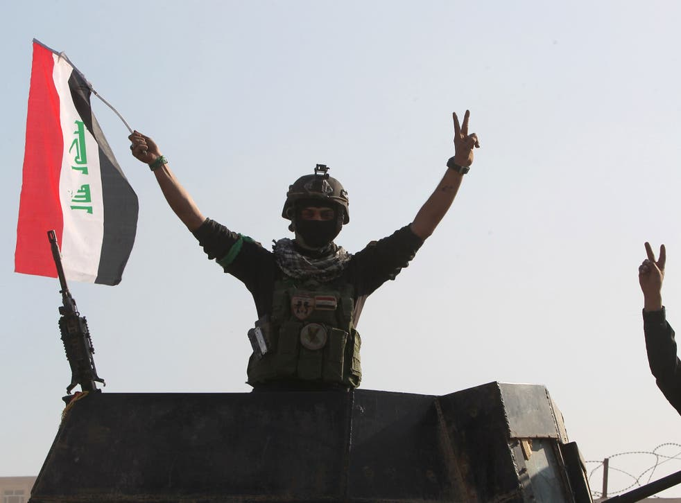 Government forces celebrate after recapturing the city of Ramadi