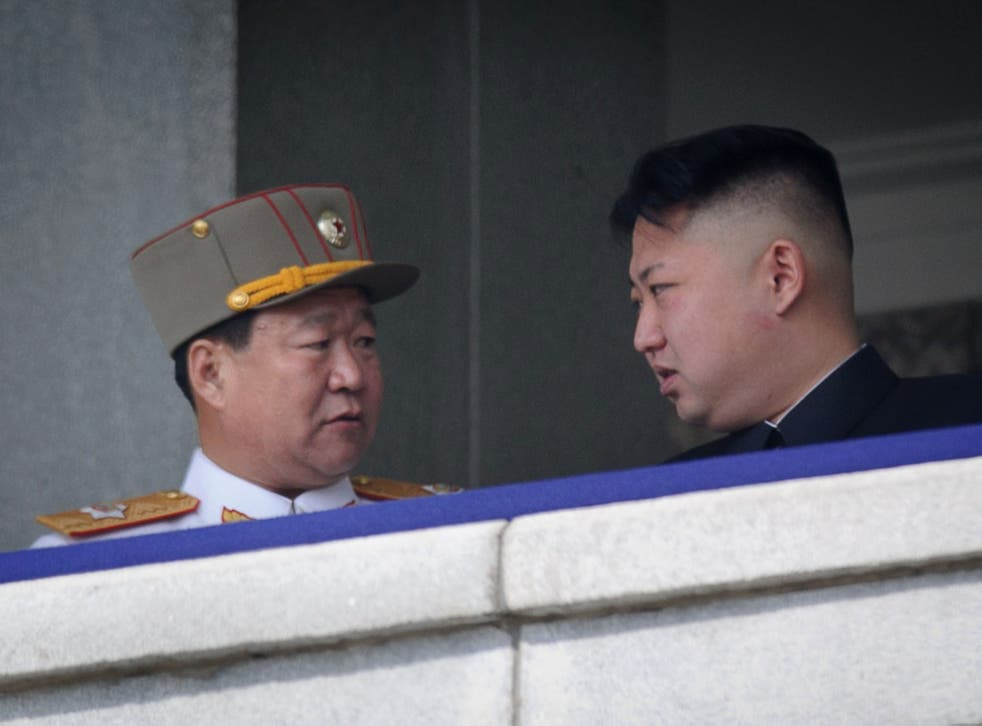 Choe Ryong-Hae (left) talking with North Korean leader Kim Jong-Un (right) attending a military parade in Pyongyang