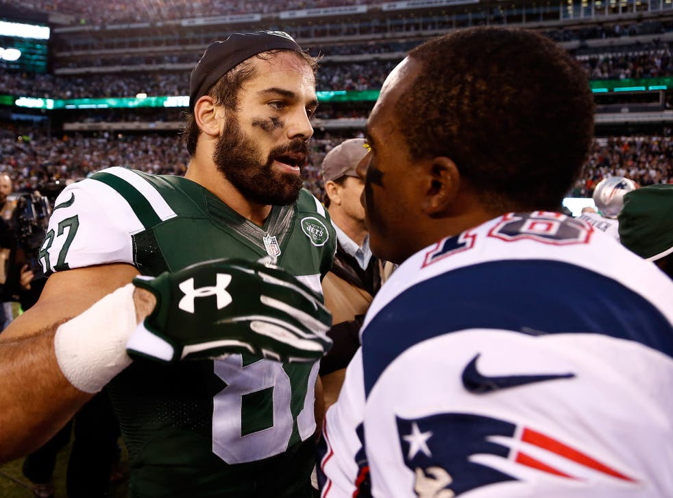 Eric Decker of the New York Jets speaks with Matthew Slater of the New England Patriots