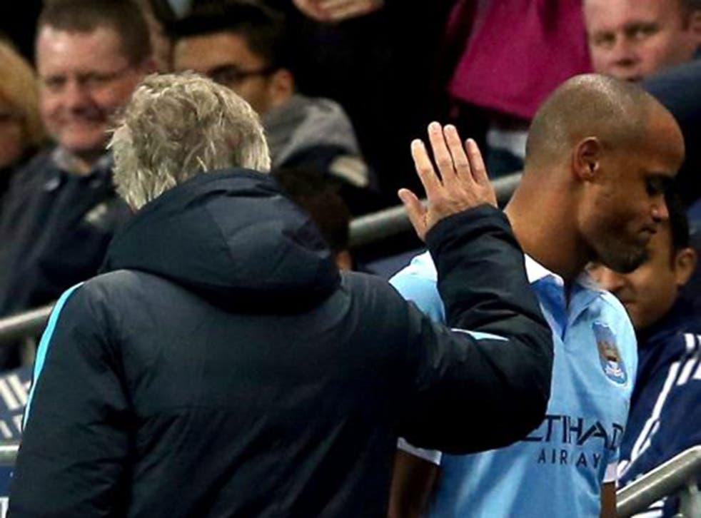 Vincent Kompany walks off injured past manager Manuel Pellegrini after a recurrence of a calf injury against Sunderland