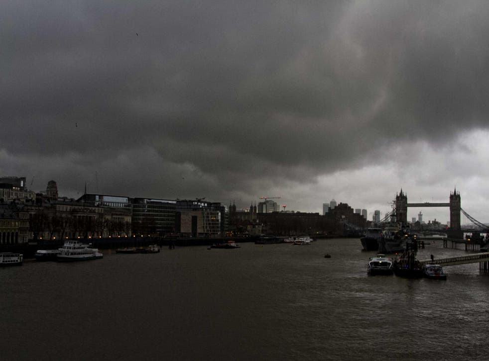Dark clouds gather over Canary Wharf and Tower Bridge