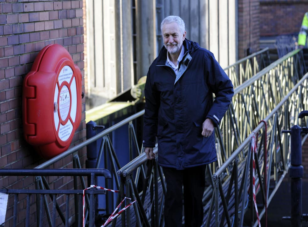 Jeremy Corbyn walks across a foot bridge at the Foss Barrier, during his visit to view flood affected areas in York