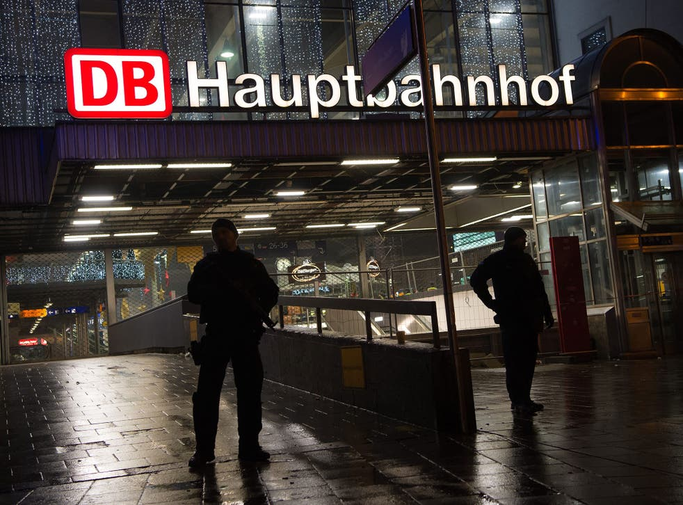 German police on duty at the main railway station in central Munich. Police evacuated Munich's main train station and a second station in the city's Pasing district in response to a credible terrorist threat to the Bavarian capital