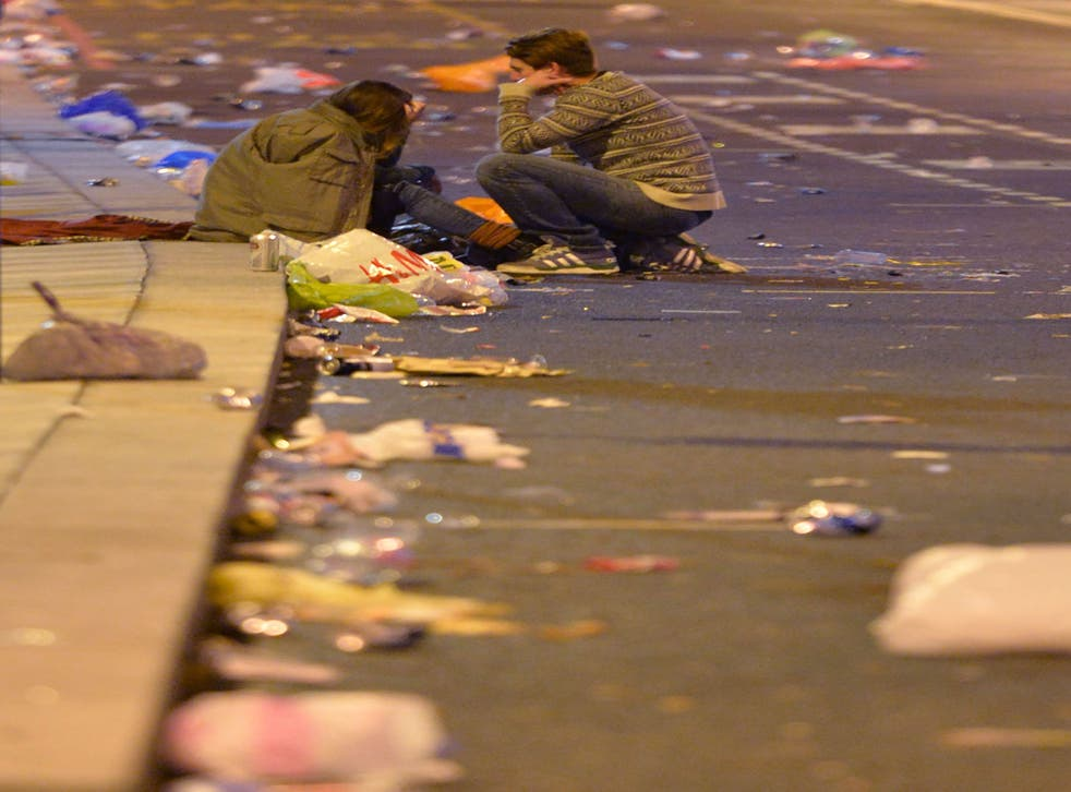 Revellers head home as the clean-up begins in central London after the New Year celebration fireworks