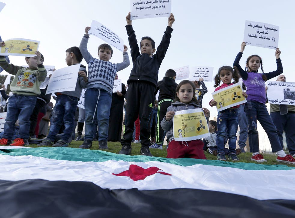 Children carry placards demanding that the siege of Madaya and Zabadani in Syria is lifted, in front of the offices of the UN headquarters in Beirut, Lebanon