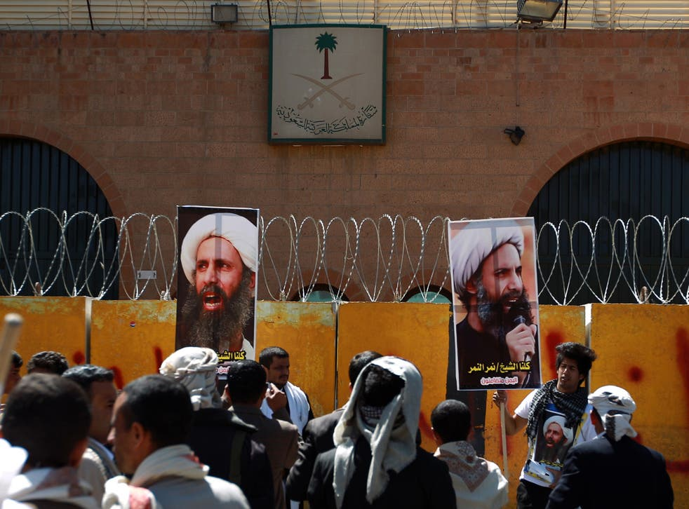 Yemeni protesters demonstrate outside the Saudi embassy in Sanaa against the death sentence of cleric leader Sheikh Nimr al-Nimr