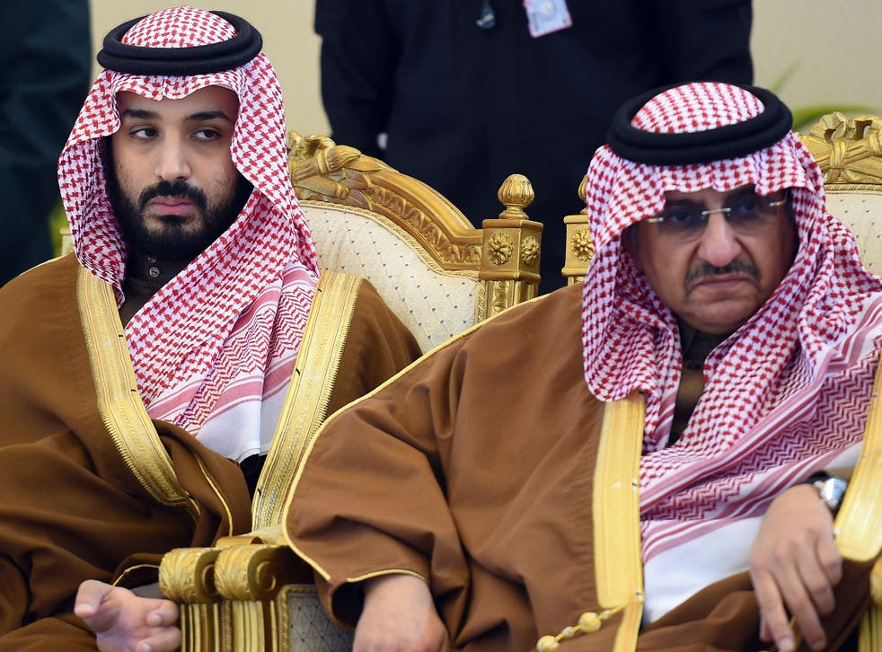 Saudi Defence Minister Mohamed bin Salman (L) and Crown Prince and Interior Minister Mohammed bin Nayef