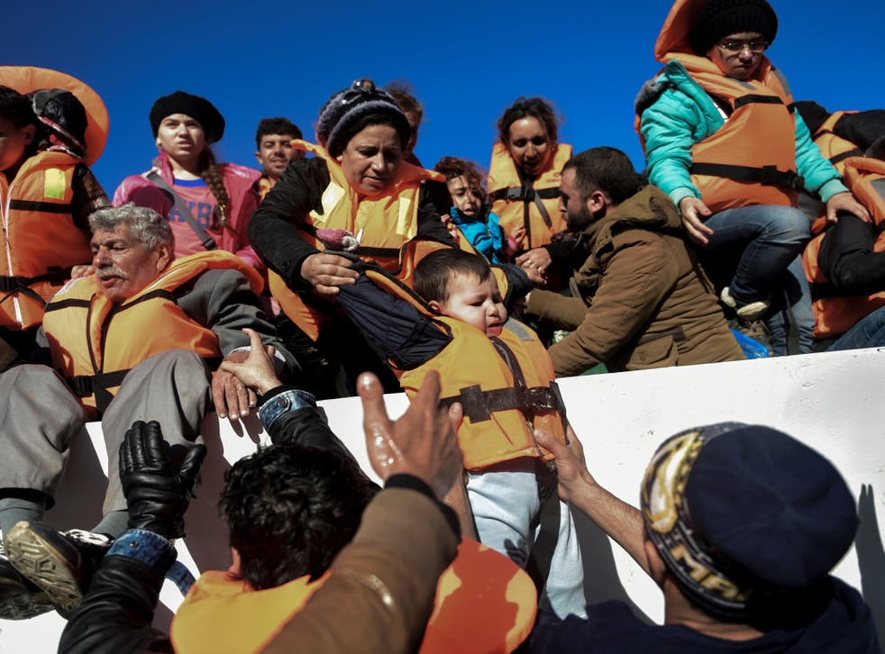 Refugees being rescued on the Greek island of Lesbos in photo dated 26 November 2015