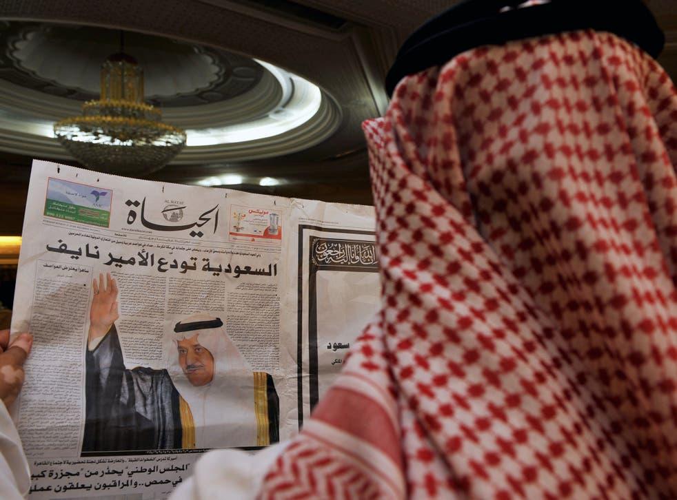 File: A man in Jeddah reads a local newspaper in June 2012