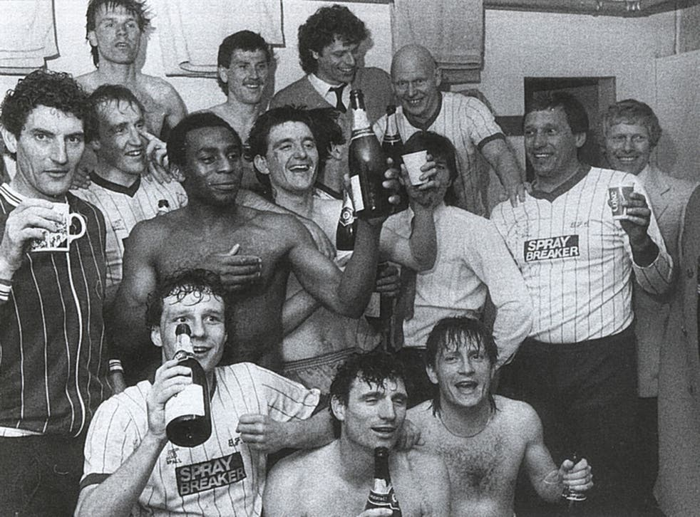 Martin Dobson (left) and his Bury players toast their promotion in the 1984-85 season