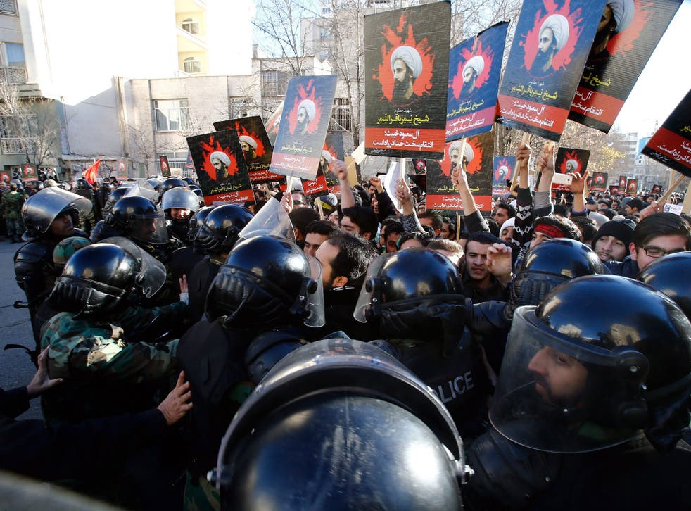 Iranian riot police and demonstrators near the Saudi Arabian embassy in Tehran, Iran, 03 January 2016