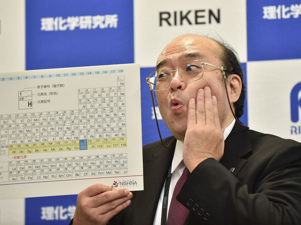 Periodic table gets four new elements making science textbooks kosuke morita the leader of the riken team poses with a board displaying the urtaz Gallery